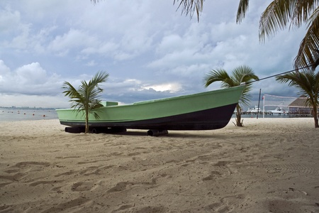 mujeres: A boat in a Beach of Isla Mujeres, Mexico
