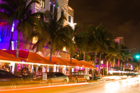 miami south beach: Ocean Drive scene at night lights, cars and people having fun, Miami beach