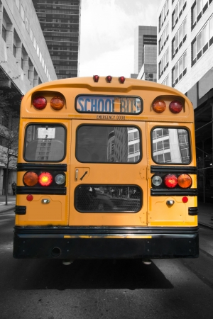 Typical yellow New York style school bus at New York City photo