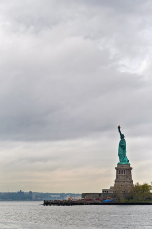Side view of the iconic Statue of liberty in Liberty Island, New York, USA