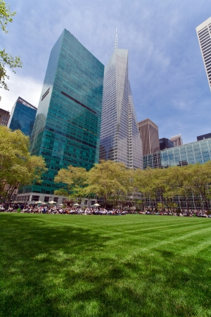 bryant park: New York, USA - May 7, 2013  A sunny day at lunch time in Bryant Park New York where people sit on the iron chairs to have their meal  It is located close to the New York Public Library, in Midtown Manhattan  Taken on May 7th 2013  Editorial
