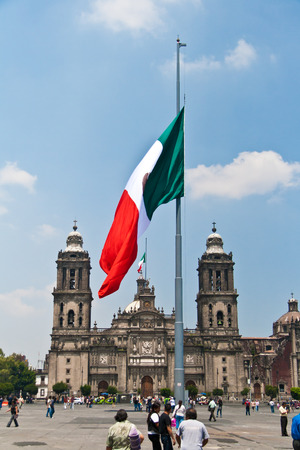 MEXICO DF, MEXICO, SEPTEMBER 19, 2011  The Zocalo or Plaza de la Constitución is the main square in Mexico City, the Capital city of Mexico  A huge flag is displayed in the center of it  The Cathedral is the main church behind it