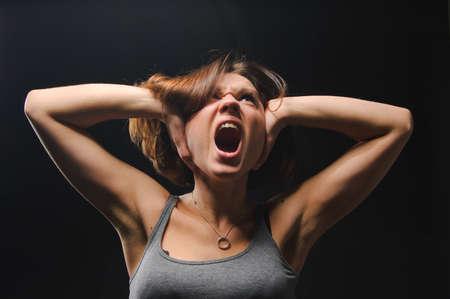 terrified woman: Screaming girl Stock Photo