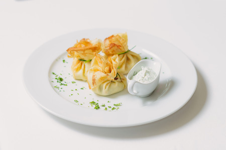 subsistence: Pancakes with salmon, sour cream and greens Stock Photo