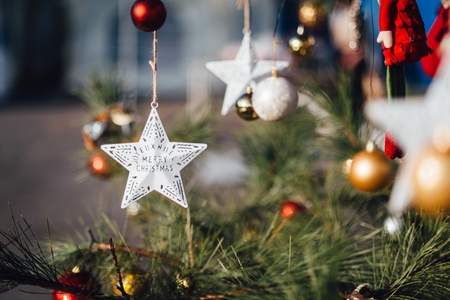 Star decoration hanging on Christmas tree