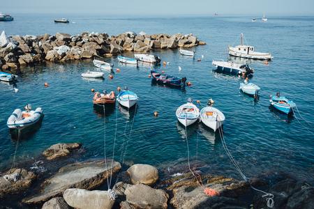 Boats in the Riomaggiore bay in National park Cinque Terre, Liguria, Italy