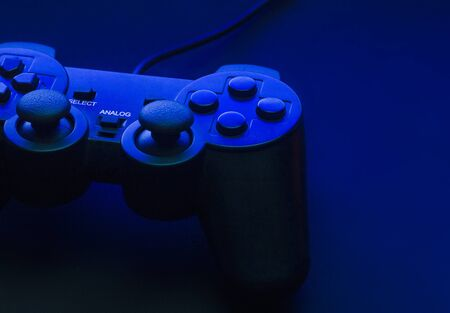 Black gamepad with blue backlight and beautiful shadows. Foto de archivo