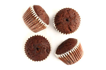 Tasty muffin cakes with chocolate, isolated on white.