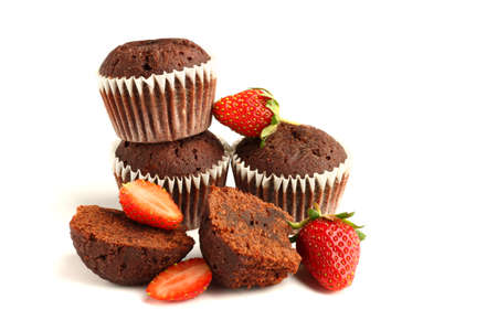 Tasty muffin cakes with strawberries and chocolate, isolated on white.