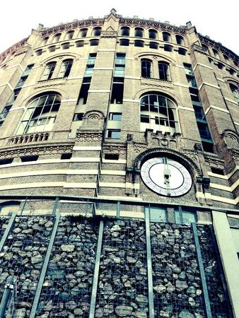 renovate old building facade: Circular historical building in vienna