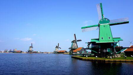 holland landscape: landscape of Windmills and river in holland
