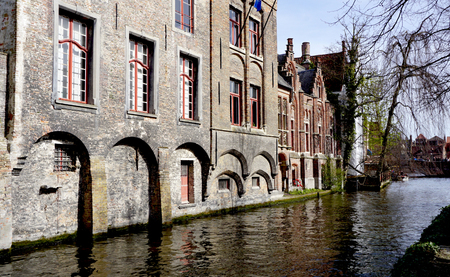 middle ages boat: houses along the river in Bruges, Belgium