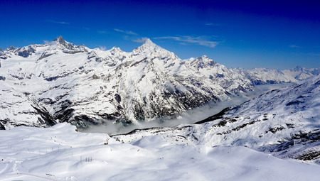 snow alps mountains and foggy with blue sky zermatt switzerland photo