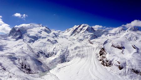 snow alps mountains view and blue sky zermatt switzerland Stok Fotoğraf