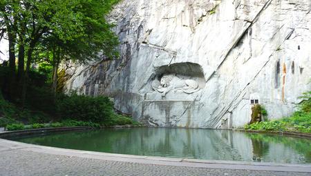 dying: Dying lion monument landmark of Lucerne Switzerland Stock Photo