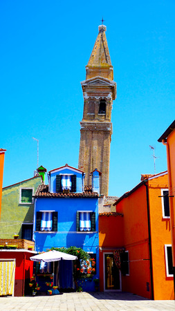 Burano: Burano churrch and colorful house, Venice, Italy Stock Photo