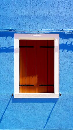 house windows: Wooden Window in Burano on blue color wall building architecture, Venice, Italy
