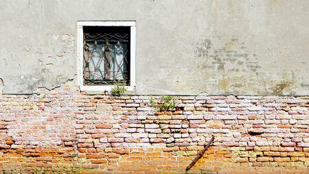 Murano: window and ancient decay wall half brick wall building architecture in Murano, Venice, Italy Stock Photo