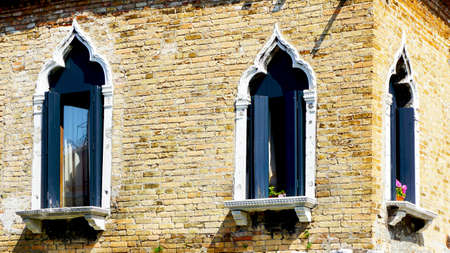 coroner: windows at coroner of house building architecture in Murano, Venice, Italy