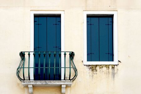 balcony window: door with balcony and window on creme wall building in Venice, Italy