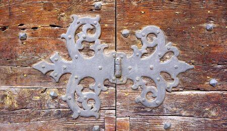 fitting in: door hinge fitting art of old wooden door in Venice, Italy