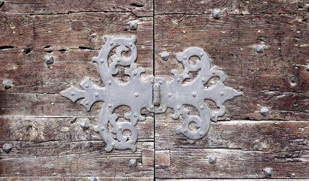 fitting in: door hinge fitting flap art of old wooden door in Venice, Italy