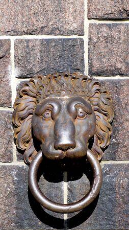 cityhall: lion door handle at cityhall in stockholm, Sweden Stock Photo
