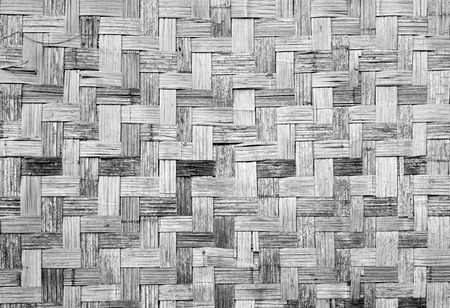 grey scale: Wall of plaited bamboo strips vernecular outdoor texture material grey scale