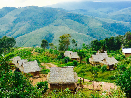 asian house plants: Viewpoints Local rural houses with mountains background in laos, asia