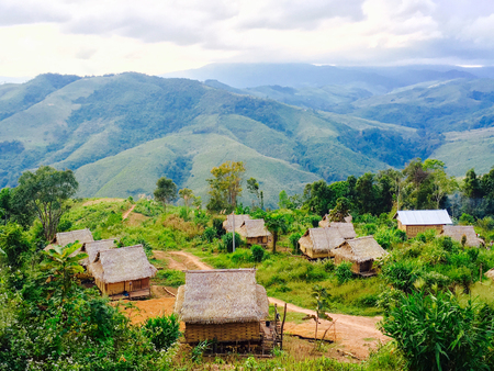 Local rural houses with mountains background in laos, asia