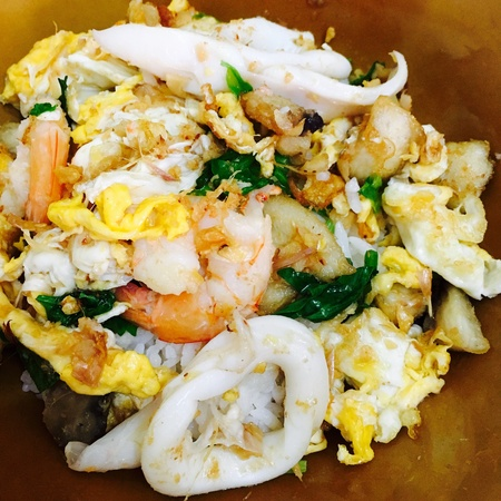Fried rice with eggs and seafood fish, shrimp, prawn, squid food cuisine Stok Fotoğraf