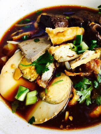 Chinese roll noodle soup black source