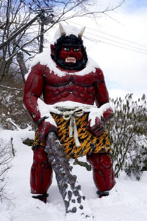 Red giant myth sculpture at Noboribetsu onsen snow winter national park in Jigokudani, Hokkaido, Japan Stok Fotoğraf