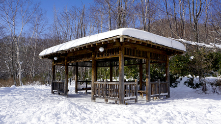 Snow and wooden pavilion environment in the forest Noboribetsu onsen snow winter national park in Jigokudani, Hokkaido, Japan