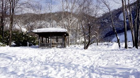 Snow and wooden pavilion landscape in the forest Noboribetsu onsen snow winter national park in Jigokudani, Hokkaido, Japan