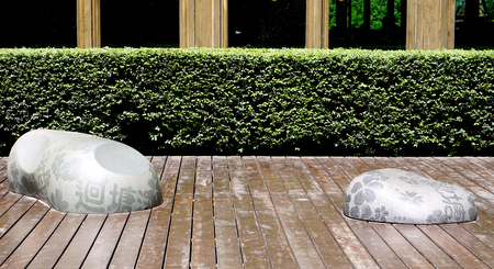freeform stone seating on wood terrace in the garden in Beitou, Taiwan