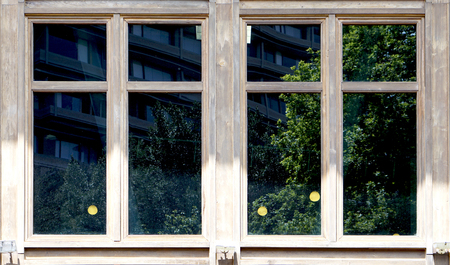 wooden window architecture with green reflection in the glass in Taiwan 스톡 콘텐츠