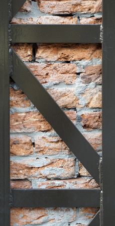 brick detail material and texture with rustic metal closeup 스톡 콘텐츠
