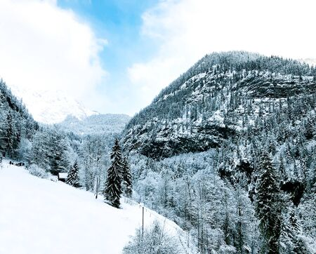 Hallstatt dreamscape winter snow mountain landscape outdoor adventure with blue sky in snowy day, Austria