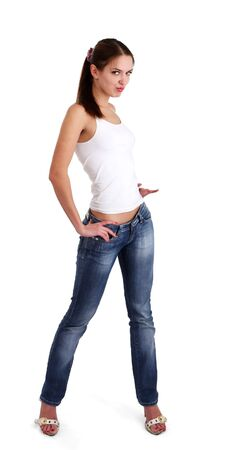 undressing woman: isolated nice woman on jeans and white tanktop Stock Photo