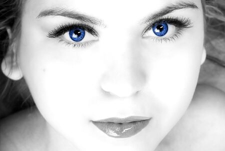womans with blue eyes portrant black and white photo