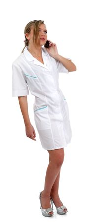 smock: Hospital nice nurse on white smock whith mobile phone
