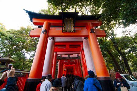 Fushimi Inari Shrine is famous for its thousands of vermilion Torii gates (Japanese red gates). Редакционное