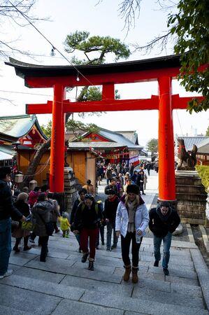 Main entrance Torii gates (Red Gates) of Fushimi Inari Shrine (Japanese Temple). Редакционное