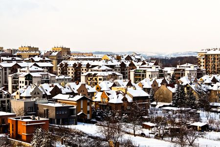 executive apartment: Snow in the city on the roofs and in the gardens. Stock Photo