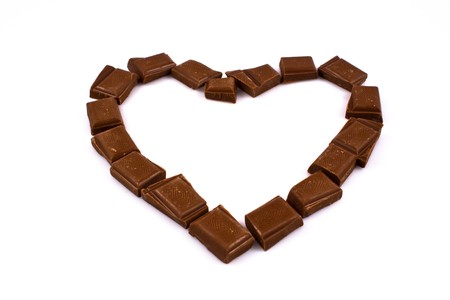 express feelings: Chocolate heart isolated on white. Great way to express feelings. Stock Photo