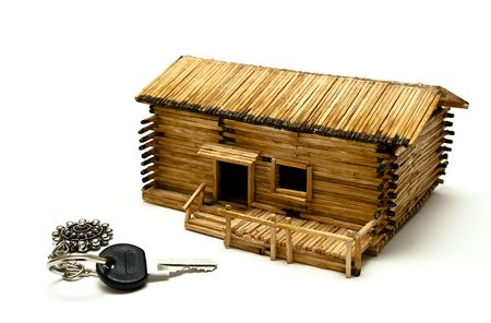 A key for new house next to a wooden follly. Stock Photo - 5244139