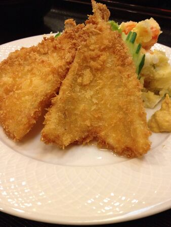 Fish fried with vegetable and egg salad