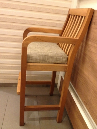 Children chair with wooden wall