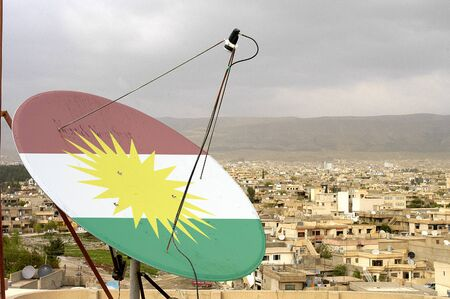 over the Kurdistan flag satellite dish Stok Fotoğraf